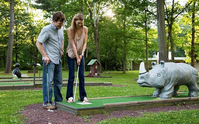 nice couple golfing mini golf
