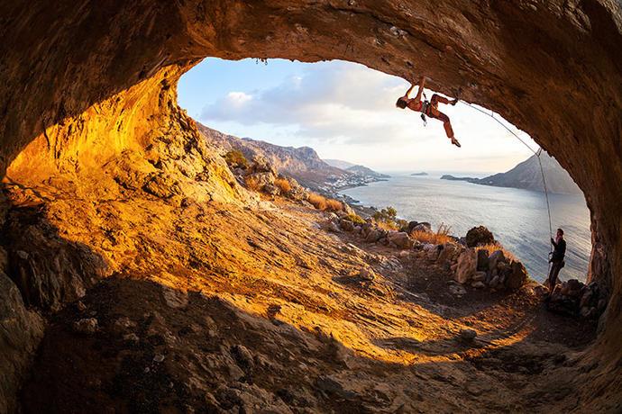 beautiful couple rock climbing