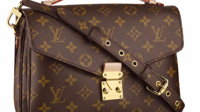 Designer bags with logos all over them: You've spent money to promote the brand