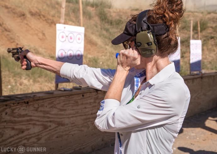 A woman practicing shooting a revolver.