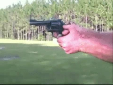 A competition shooter showing a quick revolver reload.