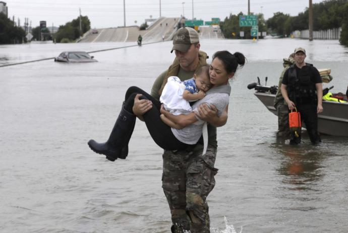 This now infamous picture was taken on the freeway right next to a well known mall. The bayou which is just beyond the trees in the distance jumped it's banks and flooded any and everything within a 2+ mile radius trapping residents who had not yet evacuated and severely damaging local buisnesses.