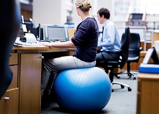 Sitting on an exercise ball helps hold your pelvis forward: that's a good thing!