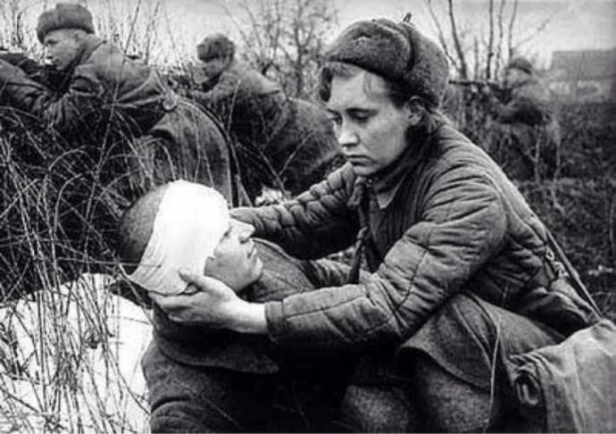 Peshkova Helping an Injured Comrade