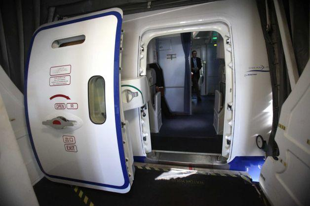 Air pressure seals the door tightly during flight. It won't just