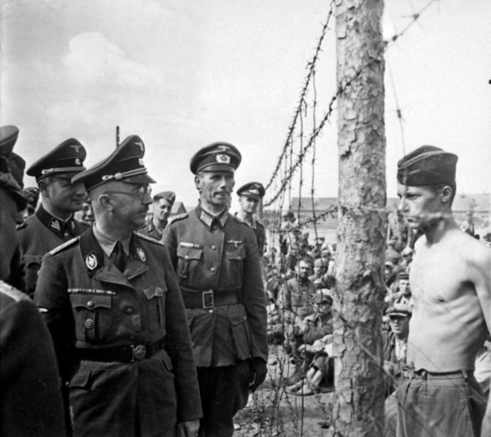 Heinrich Himmler staring at emaciated Russian POW.