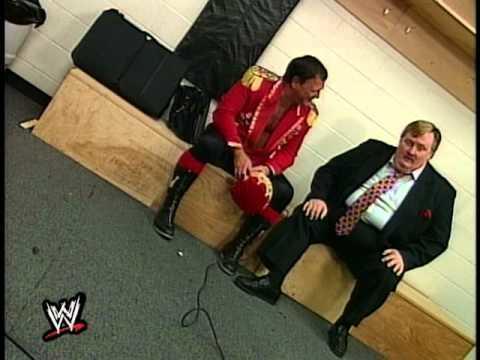 Still of awkward conversation between Jerry Lawler and Paul Bearer.