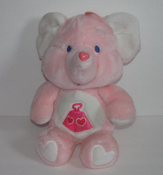 I had this Care Bear Elephant. (actually, I still have it in a bag in the attic).