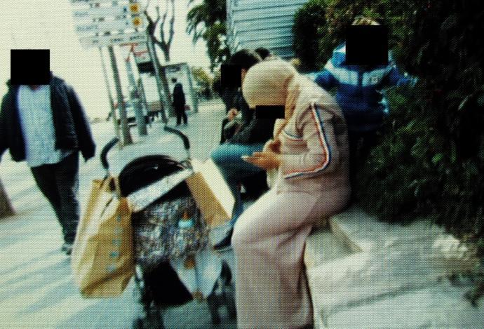 Hijabi Woman At bus Stop