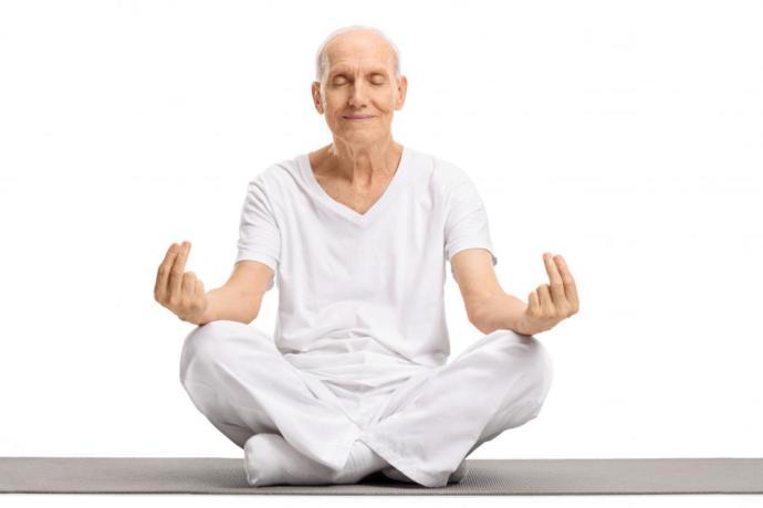 Old man meditating his spiritual wellness to grow stronger