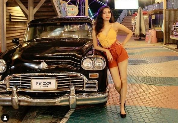 Tall Girl Posing Next To Her Vintage Car