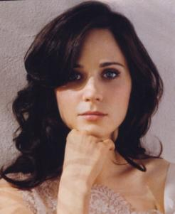 Zooey Deschanel's got average features, but eyes and luscious hair make her stand out.