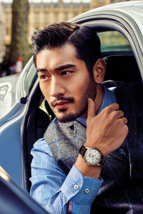 Godfrey Gao, with facial hair and a nice watch