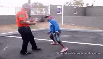 Short guy knocking out tall guy