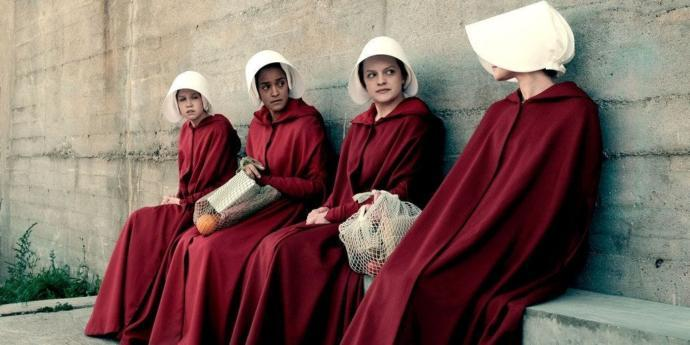 The bridesmaid are forced to wear a red cloak and white hat