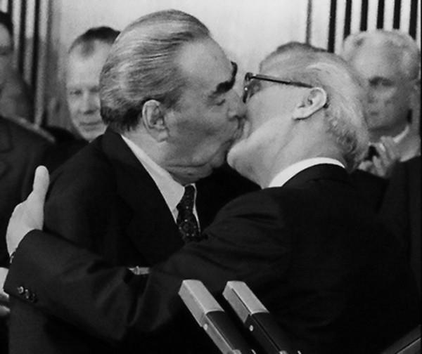 Don't let this picture fool you. the Socialist fraternal kiss was a greeting, not a sign of affection.