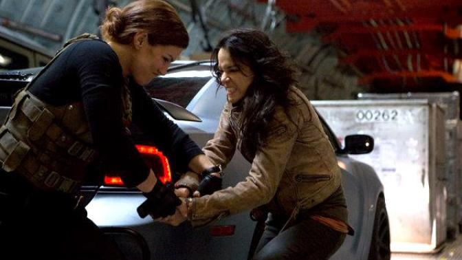 Movie and tv show fight scenes where a smaller woman takes on a larger woman