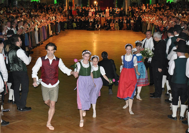People wearing ballet shoes and the traditional dress of Austria