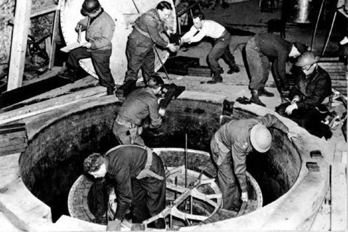 American and British engineers dismantling German nuclear reactor
