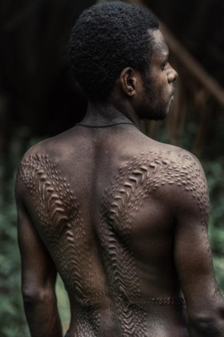 Tribal scars that have nothing to do with my story [Photo by Trevor Cole on Unsplash]