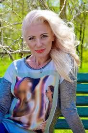 This is NOT Oksana but this woman is similar in appearance.