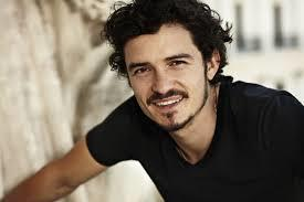 DO you like this guy better with or without the facial hair, and do you find him attractive?
