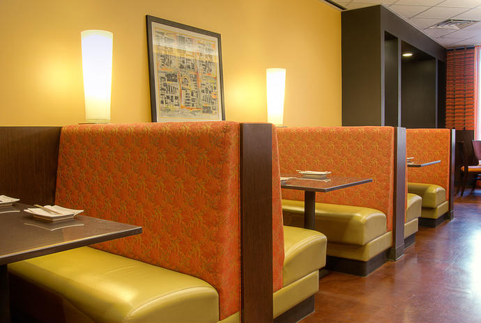 When sitting in a booth do you prefer to sit by the wall or on the out side?
