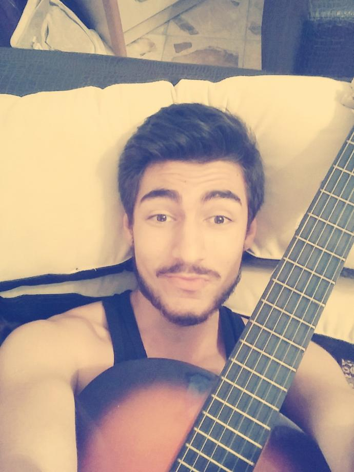 How many of you guys play the guitar or just me (with photo)?