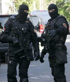 Girls, Is it attractive if a guy you are dating is in a SWAT team (picture included)?