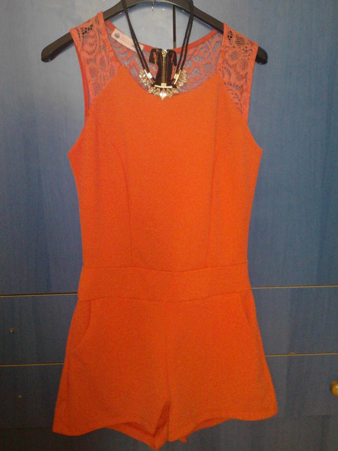 What colour is the dress? Pink or Orange?