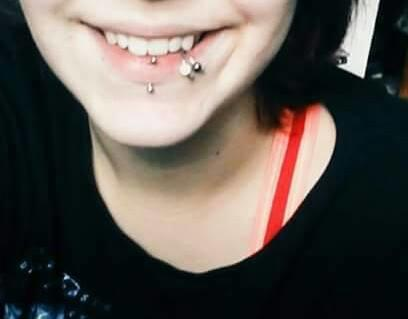 I have 3 lip piercings. Two on the side of my lip and one in the middle..Is that unattractive?
