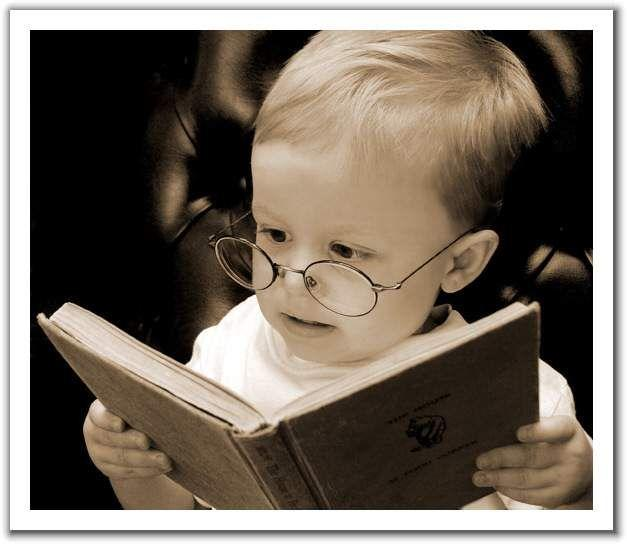 Do you prefer to read with a Kindle/Nook or an actual book? Why?