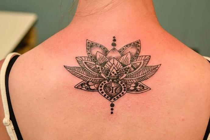 back tattoo vs arm tattoo?