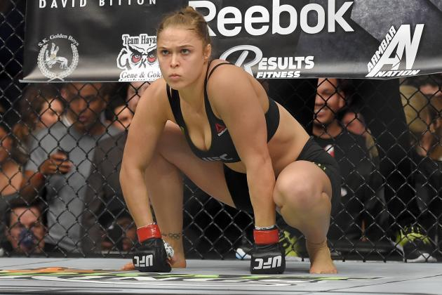 Guys, if Ronda Rousey wasn't famous and you just saw her walking down the street would you find her attractive?