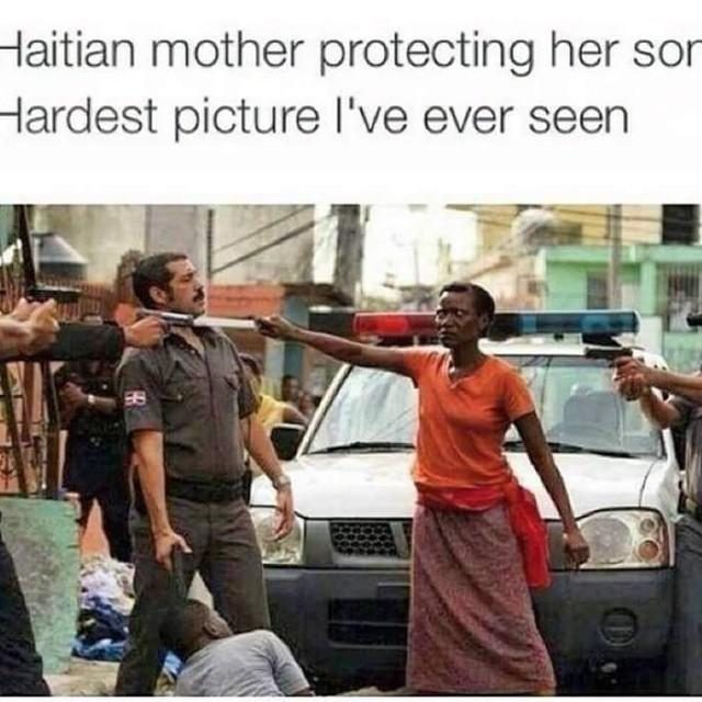 What do you think of this photo of a Haitian mother protecting her son from police abuse?