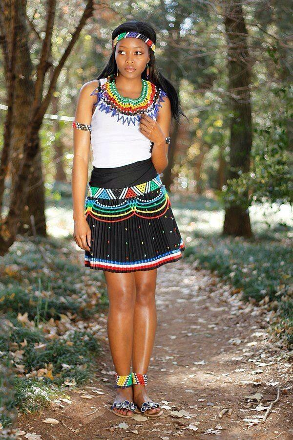 Is this a pretty South African girl, in your opinion? What about her colorful attire. Flattering and becoming of her, or no?