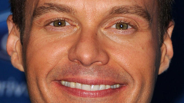 Is Ryan Seacrest actually wearing facial and eye makeup in this picture?