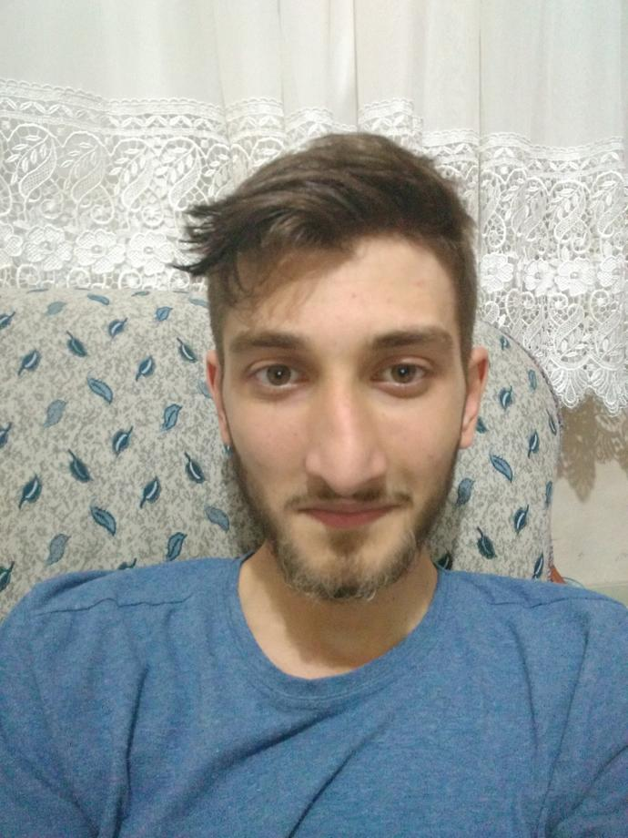 Hi.Can you recommend haircut or hairystyle? Long hair? I do not like my nose.It looks bad? How do I look?