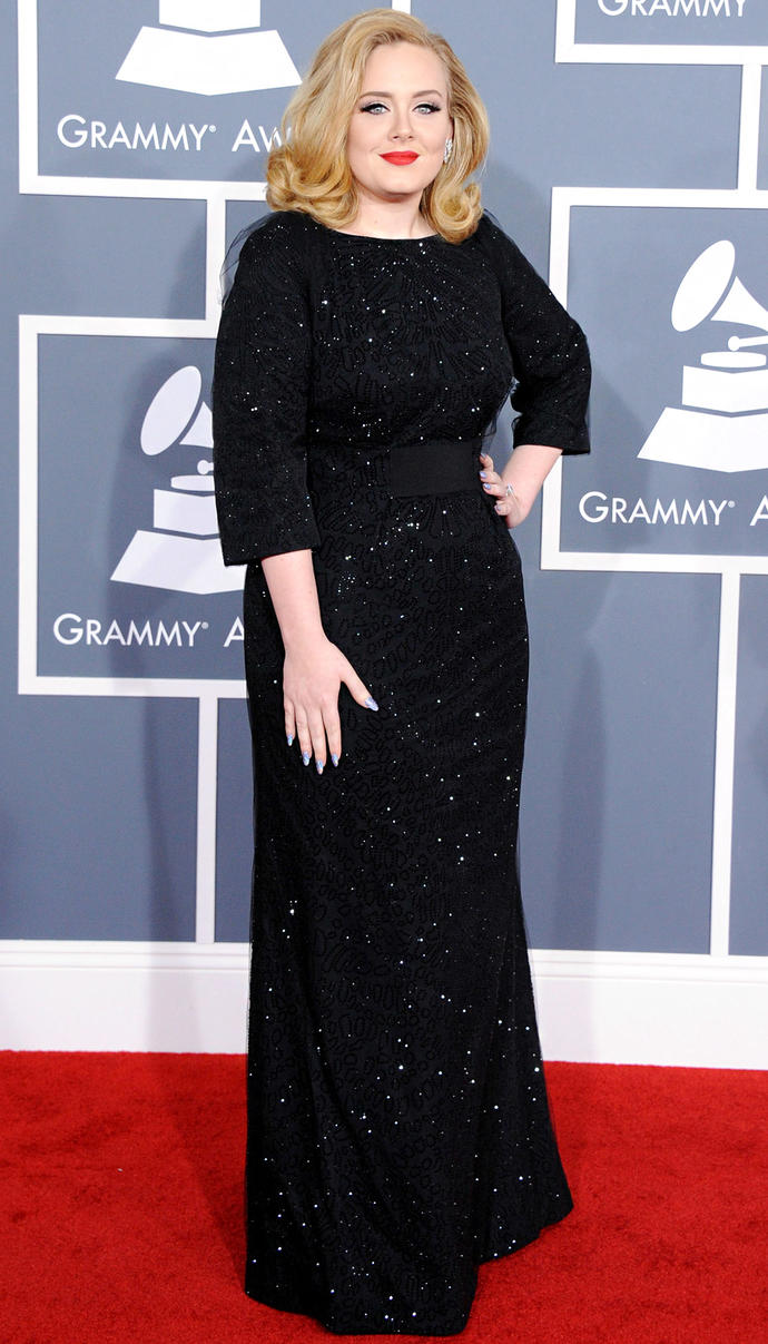 is adele ugly or hot? marks from 10?