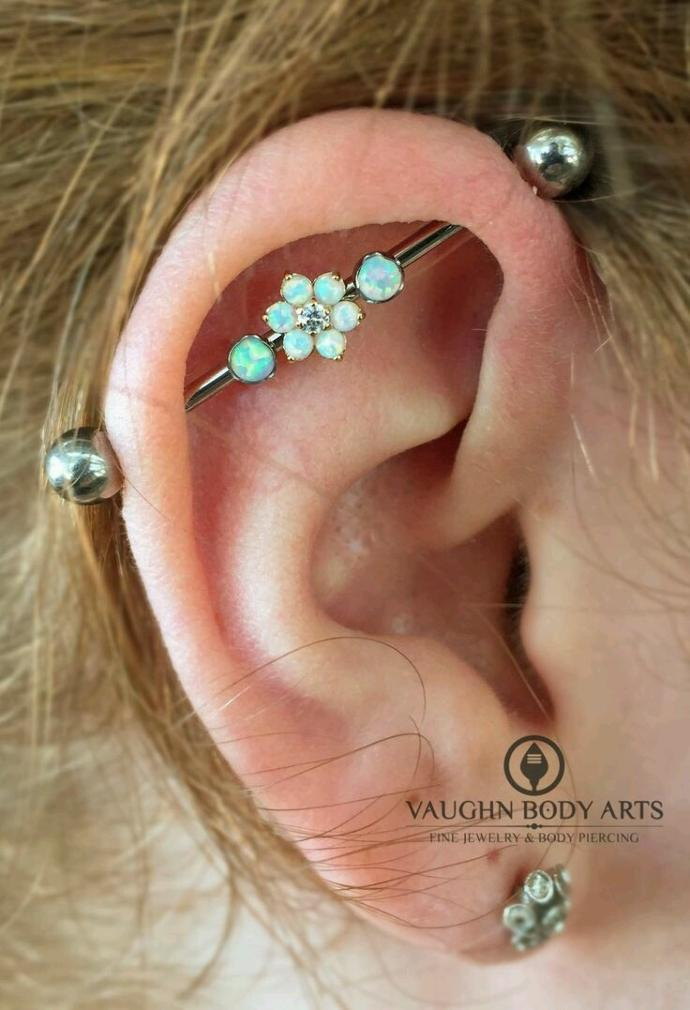 What do guys think about industrial bar piercing on girls? I want a pretty one to make it more feminine. Thoughts?