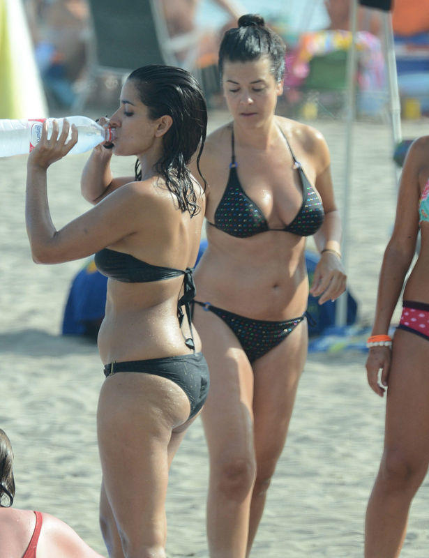 Guys, What do you think about this woman (the one who's drinking water)?