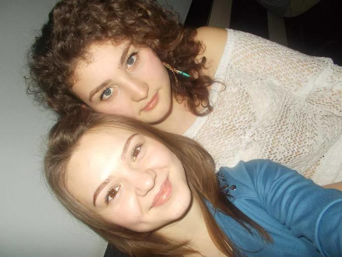 How do I look?( I am the curly one) Be honest please???