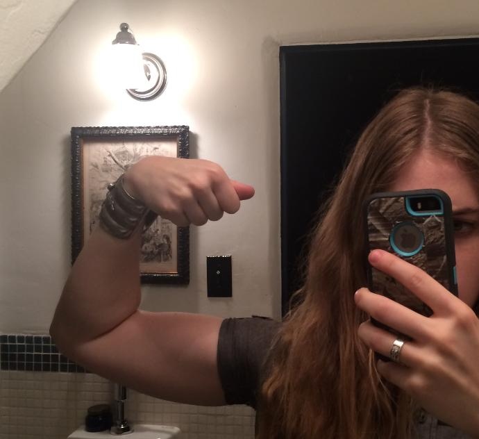 Guys, does a girl with developed biceps turn you off?