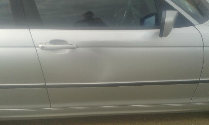 How would you say this dent was made?  Whats your thoughts this a random attack on my car,  or think it was someone that knows me?