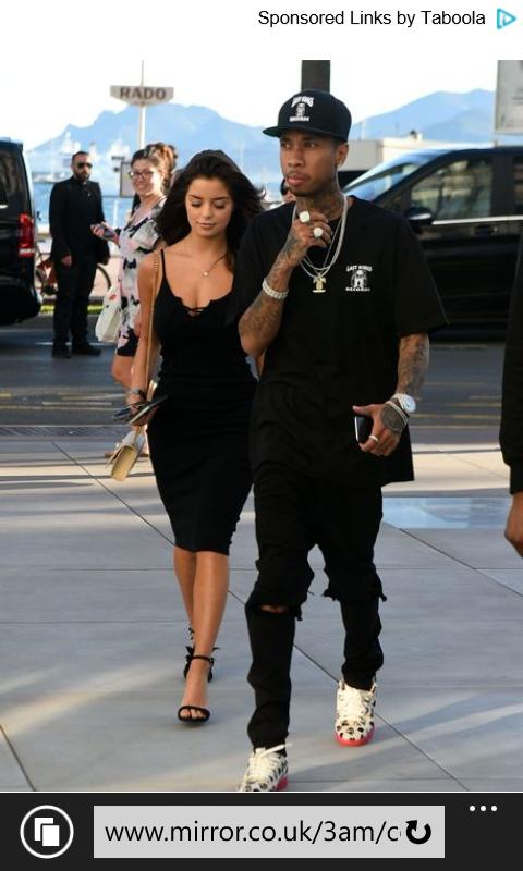 In your opinion, do you think tyga upgraded or downgraded with his new girlfriend Demi Rose? Pictures below?