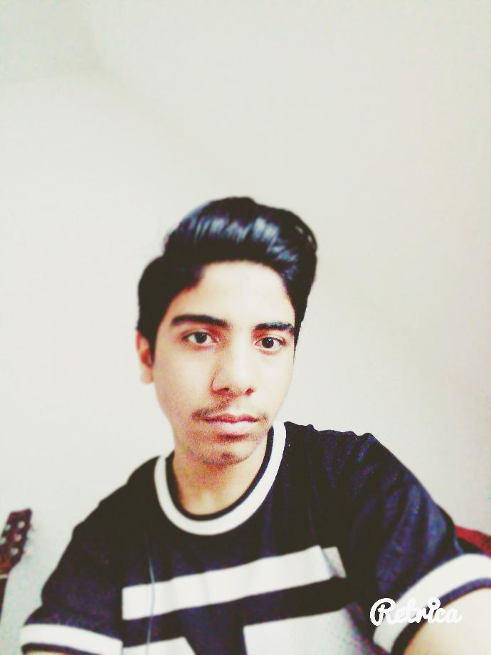 rate him how does he lookk?
