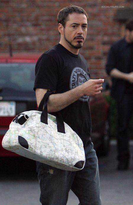 Girls, could you date a guy who wears a purse out in public?
