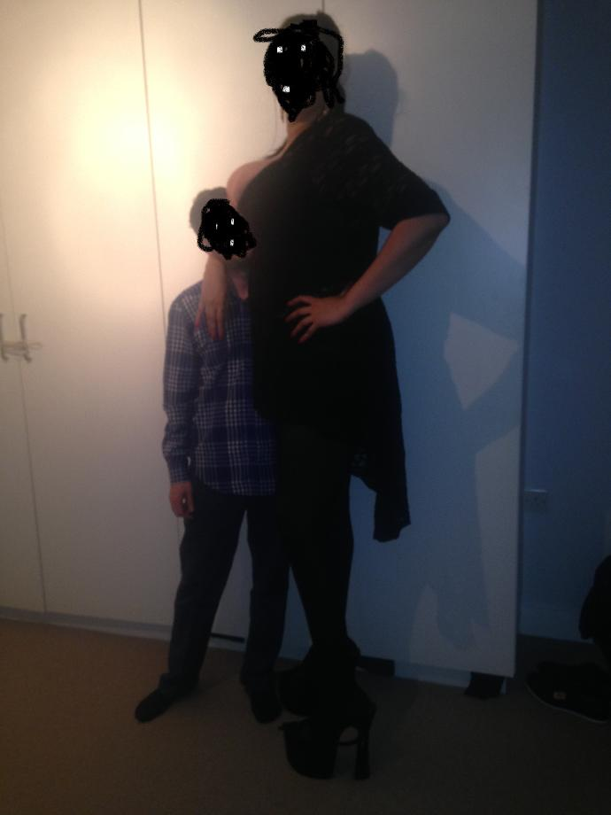 how tall do u think im or she? any chance i can beat her on wrestling match;)  ?