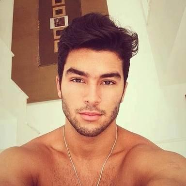 what would best describe the size of this male model's nose?