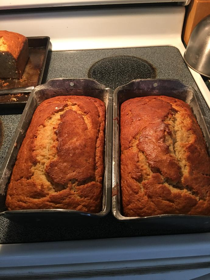 Ok who's hungry ? The Mrs . Got on a baking spree today , this is two and a half loaf of the four she baked .Half you say , see the smile on my face ?